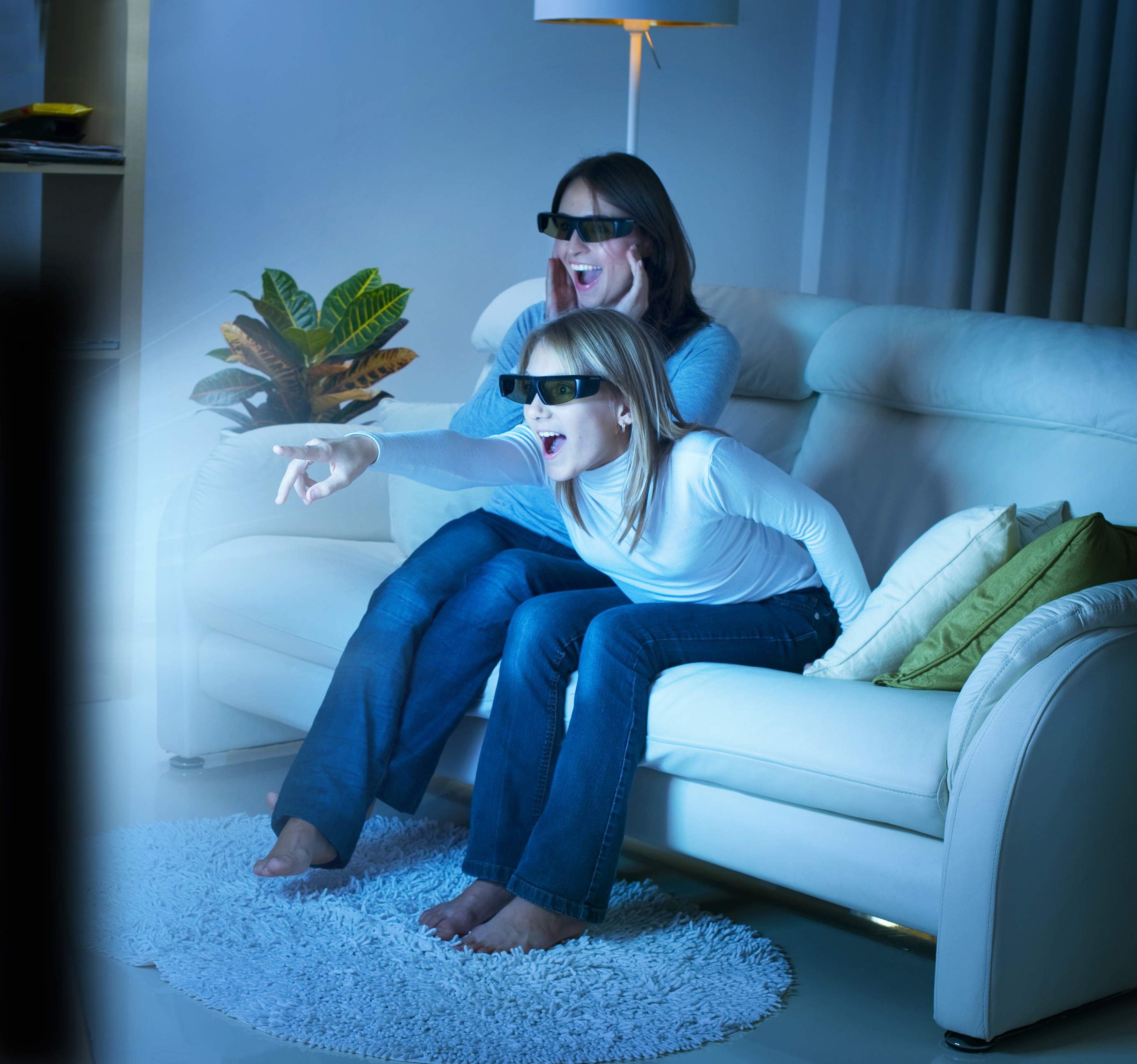 Mother and daughter watching 3D TV